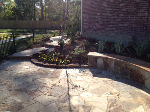 outdoor-seating-area-flagstone-hacket-stone-beautiful-seating-wall-stairway-hardscape-commercial-residential-installtion-builder-landscaper-the-woodlands-houston-spring-magnolia-conroe-montgomery-cypress.jpg