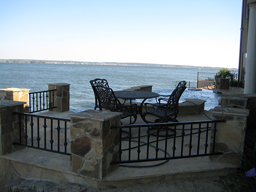 outdoor-seating-area-pool-lake-conroe-lake-conroe-stone-flagstone-landscape-pool-design-pool-builder-new-retention-walls-on-lake-best-installation-custom-design-the-woodlands-houston-spring-magnolia-conroe-montgomery-cypress.jpg