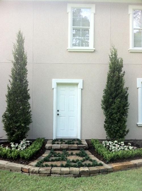 outdoor-walkway-back-door-flagstone-mondo-sparten-juniper-landscape-design-custom-build-installation-best-landscaper-top-the-woodlands-houston-spring-magnolia-conroe-montgomery-cypress.jpg