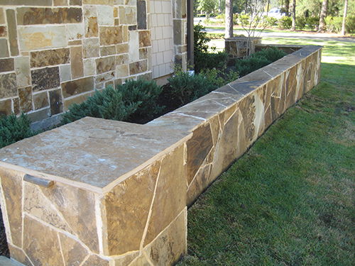 stone-wall-seating-retaining-hacket-flagstone-patio-deck-around-landscaper-installation-builder-best-landscape-company-woodforest-carlton-woods-top-luxury-the-woodlands-houston-spring-magnolia-conroe-montgomery-cypress.jpg