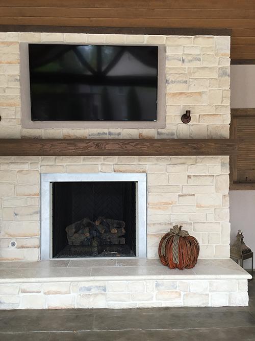 the-woodlands-tx-houston-cypress-conroe-montgomery-outdoor-kitchen-fireplace-gas-cedar-mantle-limestone-best-builder-design-landscape-landscaper-tv-over-fireplace-windows.jpg