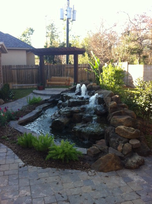 waterfall-custom-built-moss-rock-stone-rock-outdoor-large-fountain-design-install-repair-company-builds-builder-home-best-installers-patio-on-woodforest-the-woodlands-houston-spring-magnolia-conroe-montgomery-cypress-natural-pool.jpg