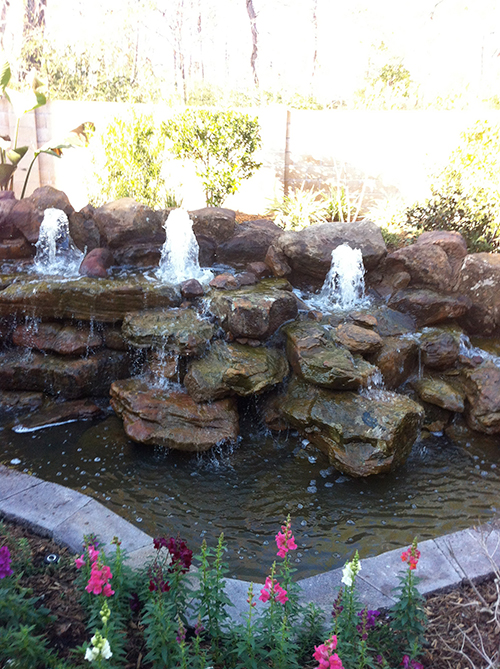 waterfall-fountain-the-woodlands-install-custom-rock-moss-rock-spring-houston-best-envy-exteriors-construction-build.jpg