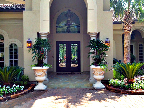 entry-landscape-pottery-urns-palms-stone-border-pavers-the-woodlands-carlton-woods-envy-exteriors.jpg