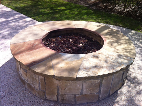 Firepit-fire-feature-glass-round-stone-landsacpe-the-woodlands-spring.jpg