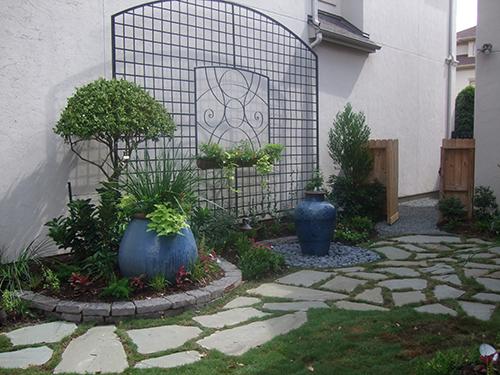 glazed-pot-pottery-urn-patio-trllis-wrought-iron-vines-landscape-flagstone-path-landscape-install-installation-best-design-designer-the-woodlands-top-spring-woodforest-montgomery-conroe-spring-cypress-build-builder-aggie-owned.jpg