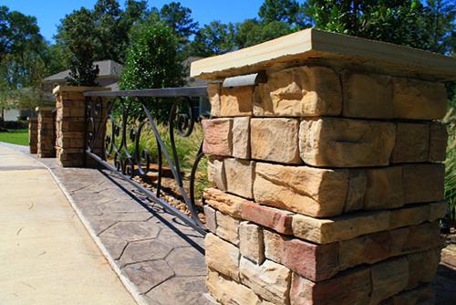 stone-column-stamped-concrete-driveway-bridge-installation-design-envy-the-woodlands.jpg