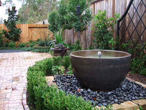 water-fountain-urn-pot-pots-planter-black-stone-pebbles-landscape-landsacper-best-install-installation-back-yard-outdoor-design-build-builder-pool-lawn-the-woodlands-envy-spring-cypress-montgomery-houston-conroe.jpg