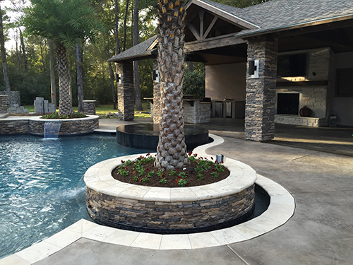 custom-outdoor-kitchen-pool-stone-hill-country-rustic-limestone-stamped-concrete-the-woodlands-woodlands,-tx-spring-houston-cedar-espresso-pool-planter-best-travertine.jpg