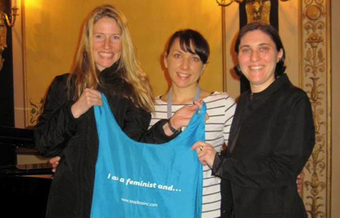 Displaying a bag at the 2012 Association of Writers & Writing Programs conference in Chicago with co-panelists and feminists Melissa Febos and Rachel Simon