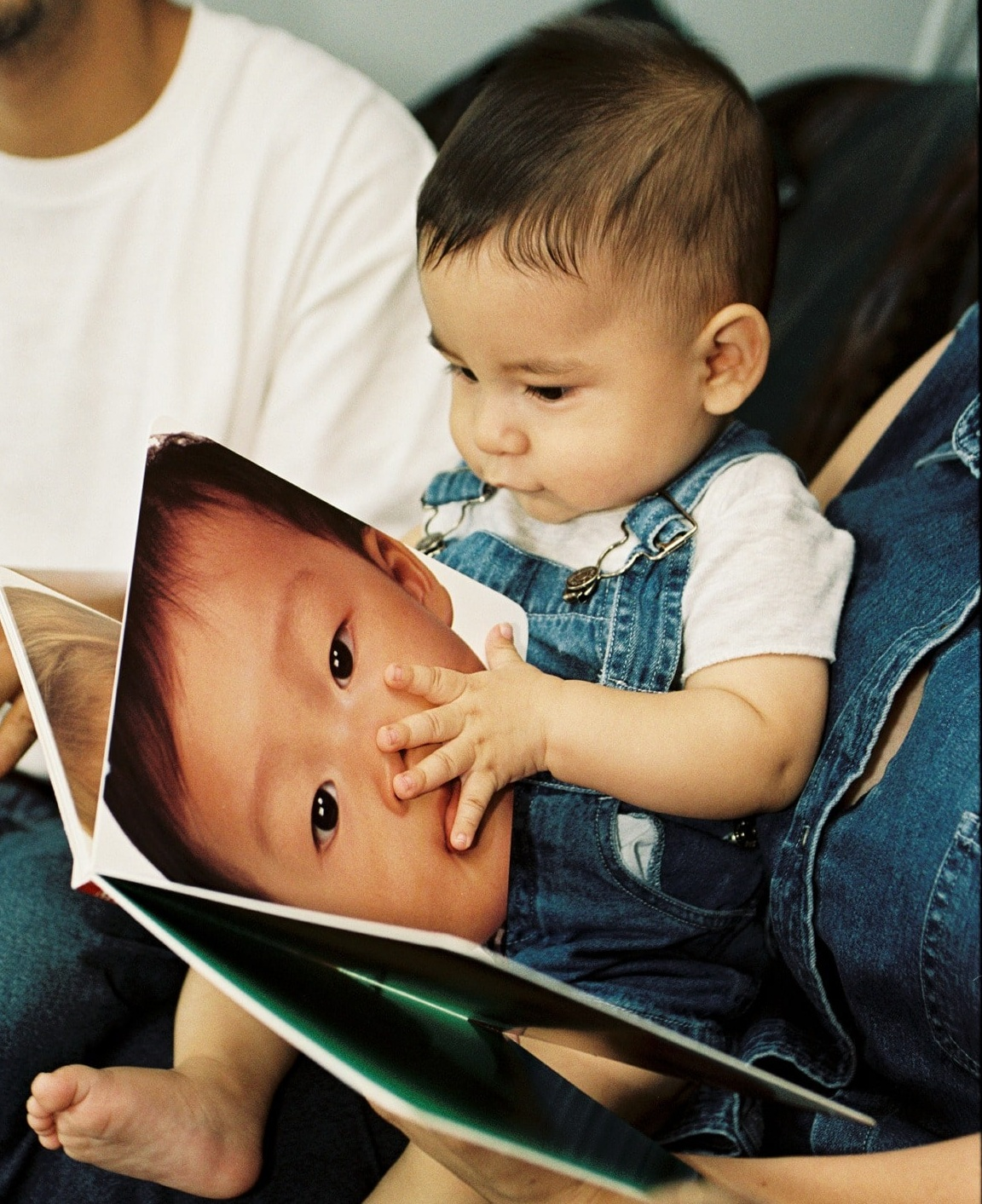 NFP - Baby looking @ the baby in the book.jpg