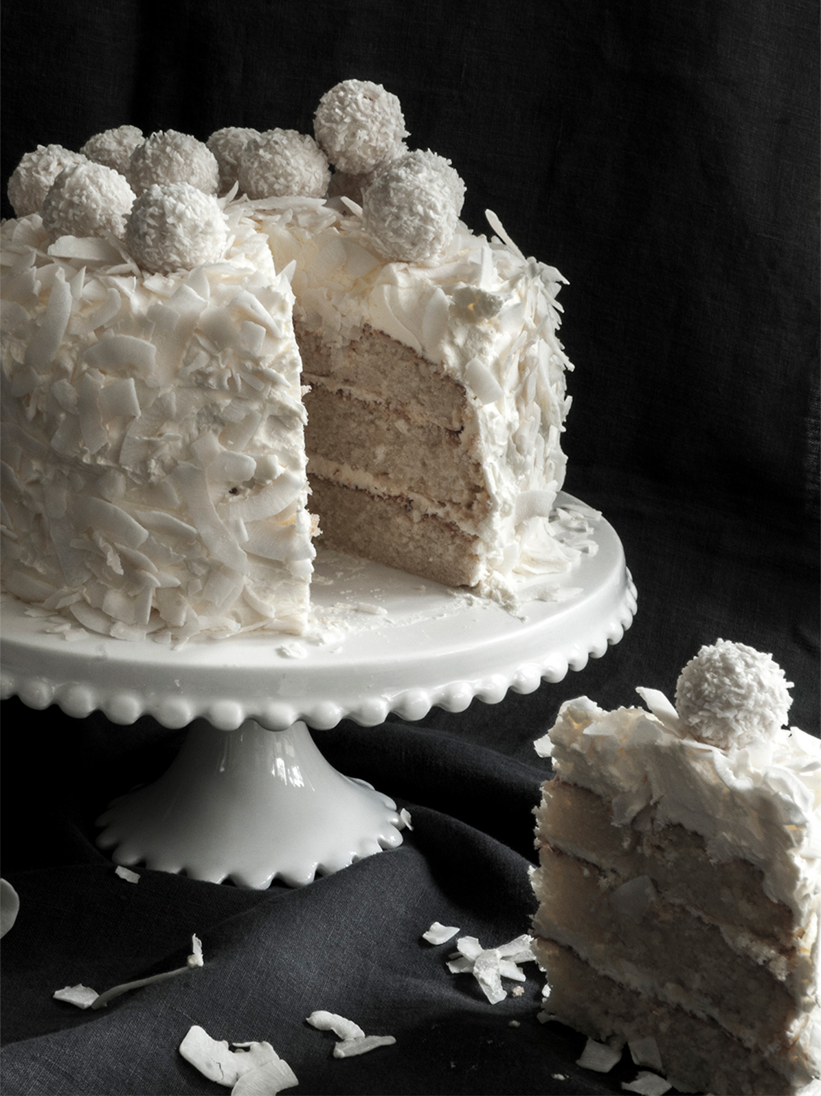 Slicing through the layers of sponge, icing and coconut on the First Communion Coconut Cake