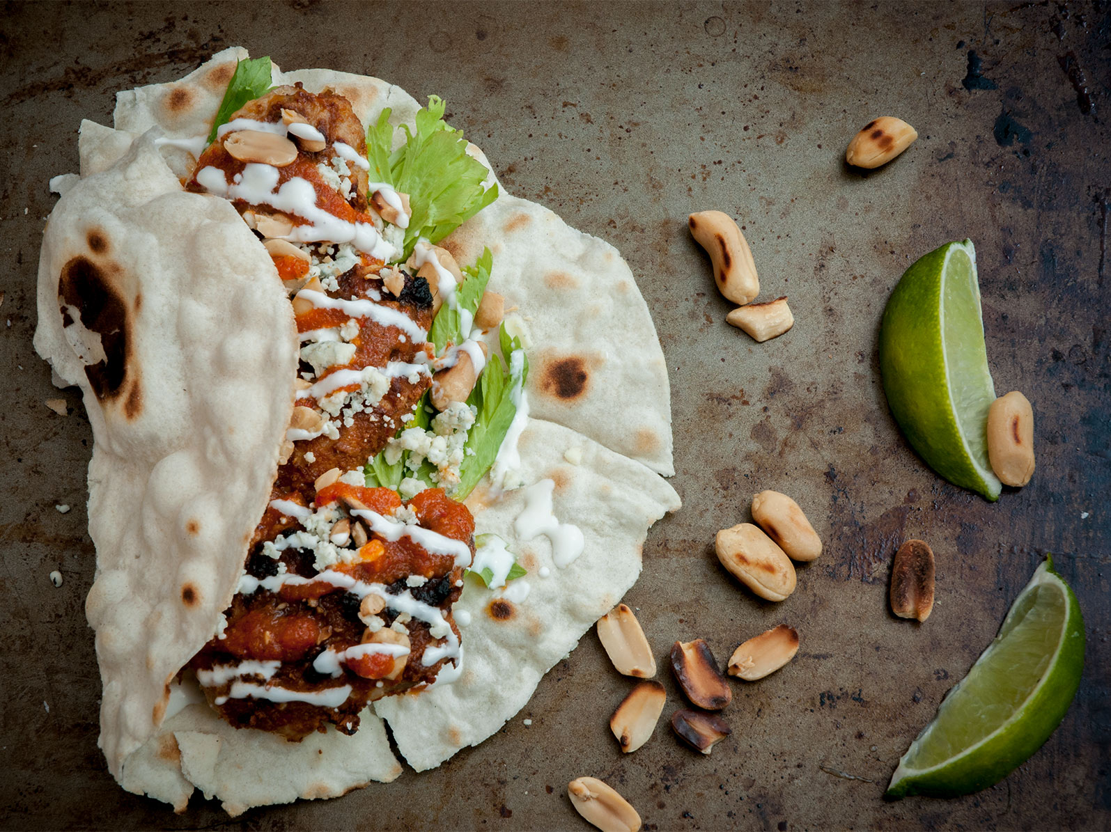 chicken wing tacos, with salsa macha, crema mexicana, blue cheese & celery hearts