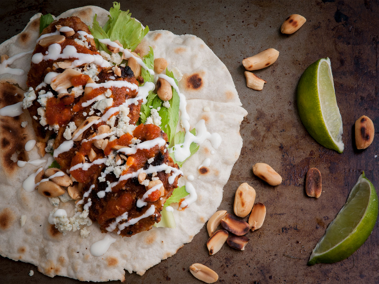 salsa macha drenched wings, sprinkled with blue cheese, crema mexicana, peanuts & lime juice