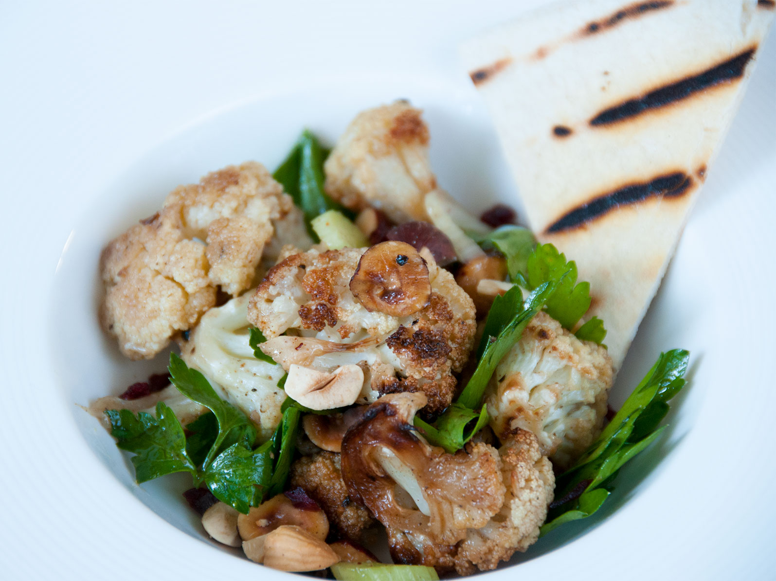 roasted cauliflower salad, with parsley and hazelnuts