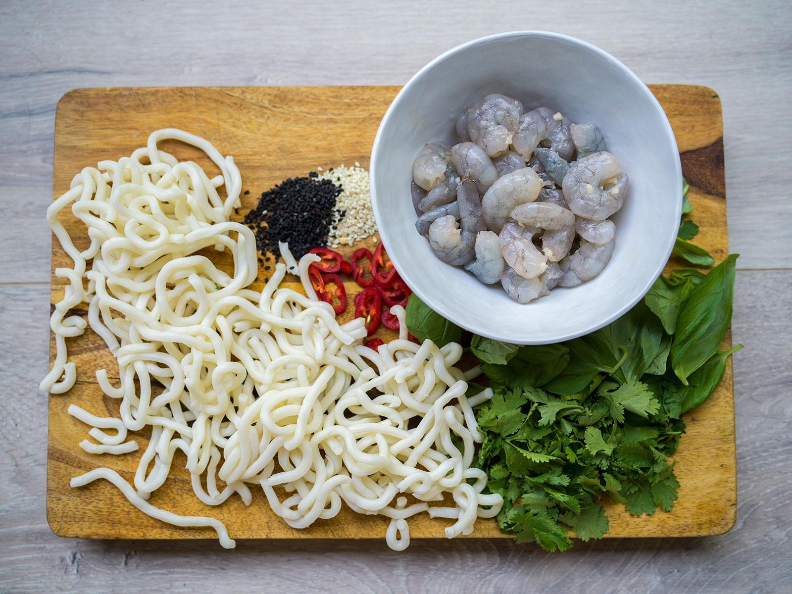 Noodles, sesame seeds, chilli, herbs & prawns