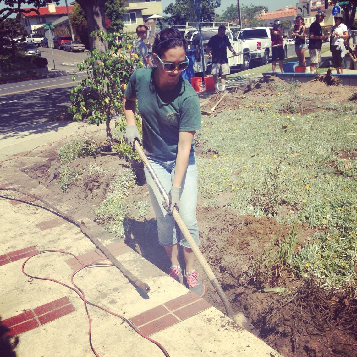 Rachael Cortez digging trenches for the brand new sprinkler system. Photo by Taylor Lewis