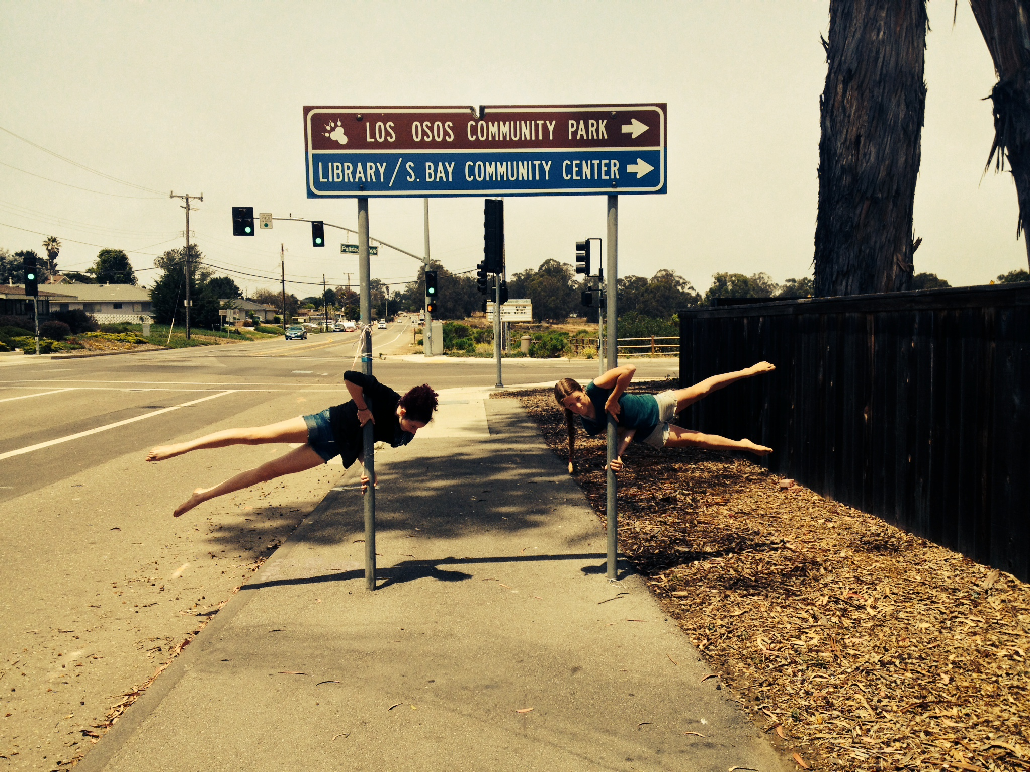Julia and Alina welcoming our Los Osos community with what they love to do, Aerials!