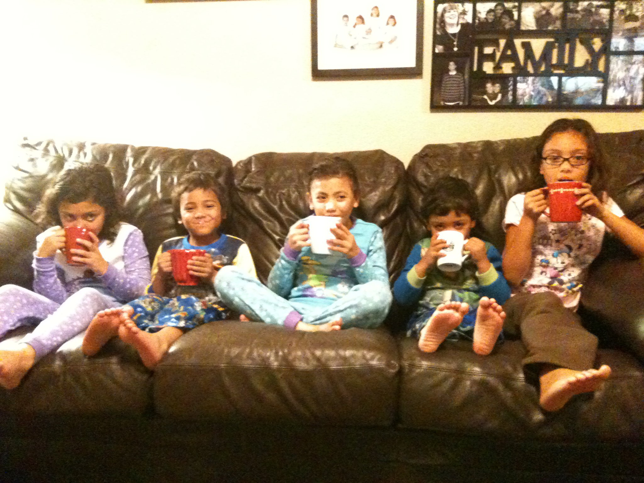 This was a few years ago, I haven't gotten a picture of them all sitting still together with their hot cocoa since! :)