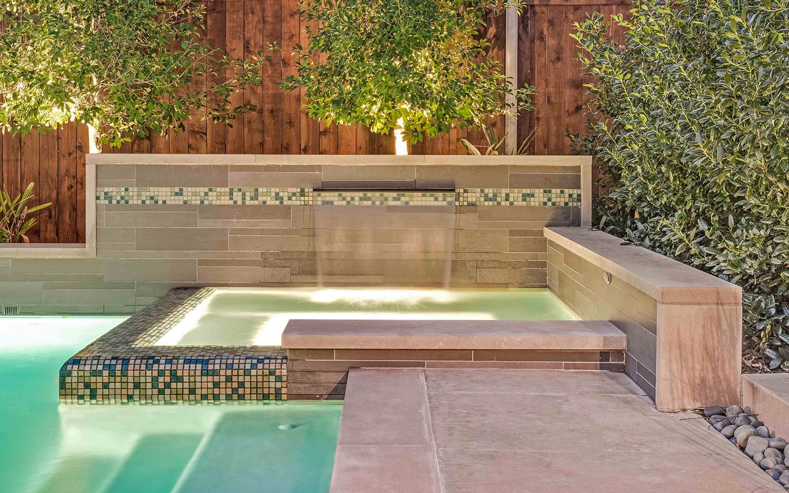 sunnyland-modern-pool-spa-fountain-night.jpg