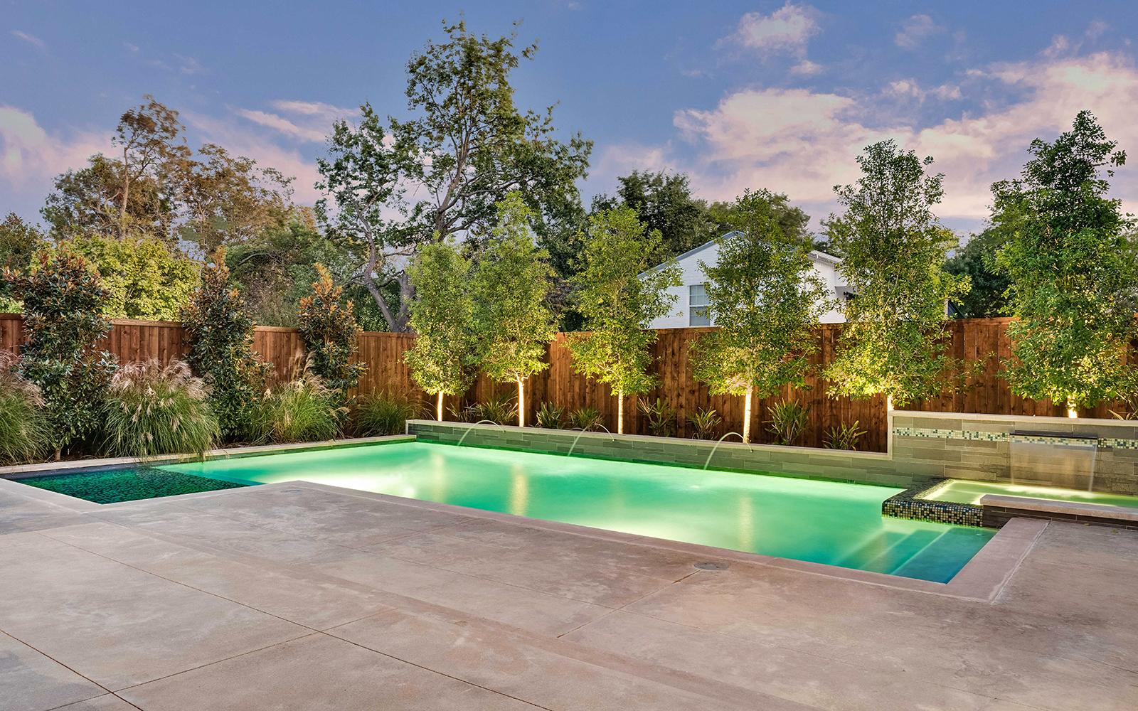 sunnyland-modern-pool-terrace-night-concrete.jpg