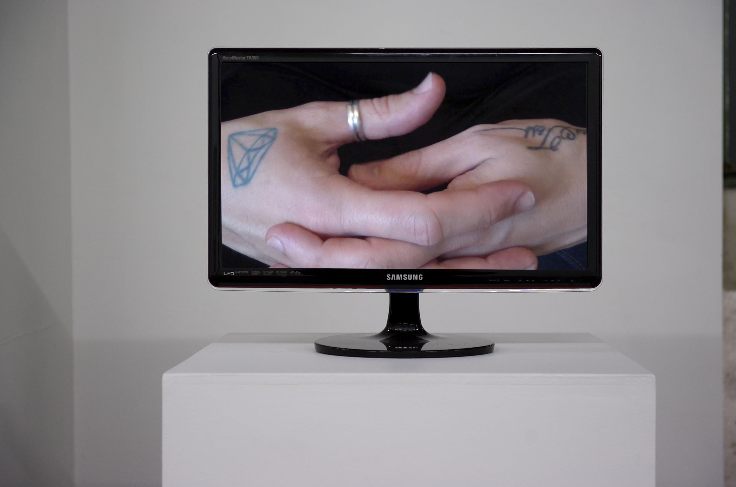 Twiddling My Thumbs (installation)  2014  HD digital video transferred to Blu-ray, silent  1 sec (looped)
