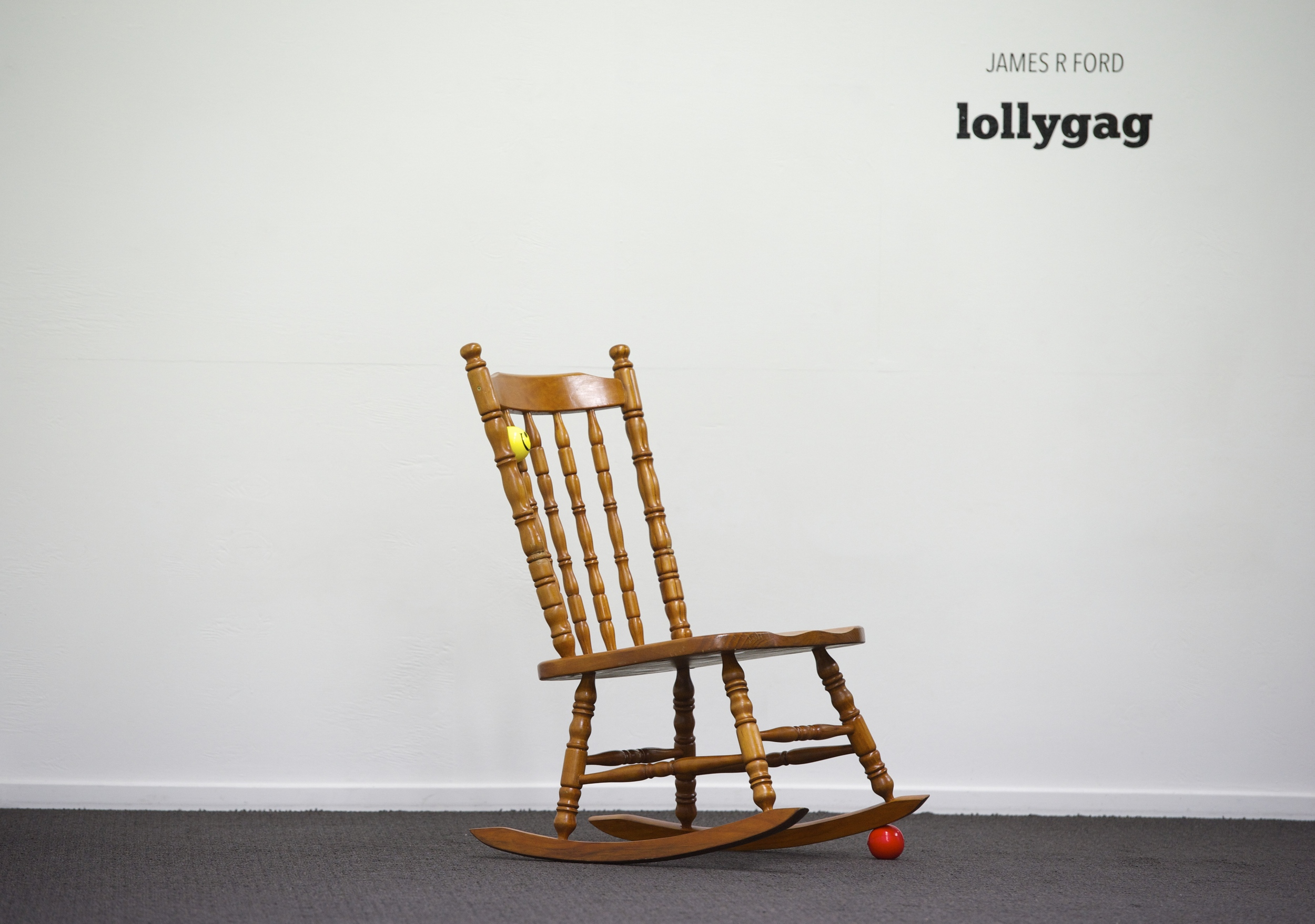 Back and forth and round and round  2014  Pine rocking chair, wood stain, foam stress balls  114 (h) x 64 (w) x 76cm (d)