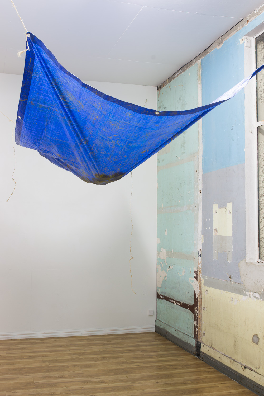Vu Nu Niu (installation)    2015    Tarpaulin, rope, turmeric and coconuts    Installation dimensions vary     Enquire