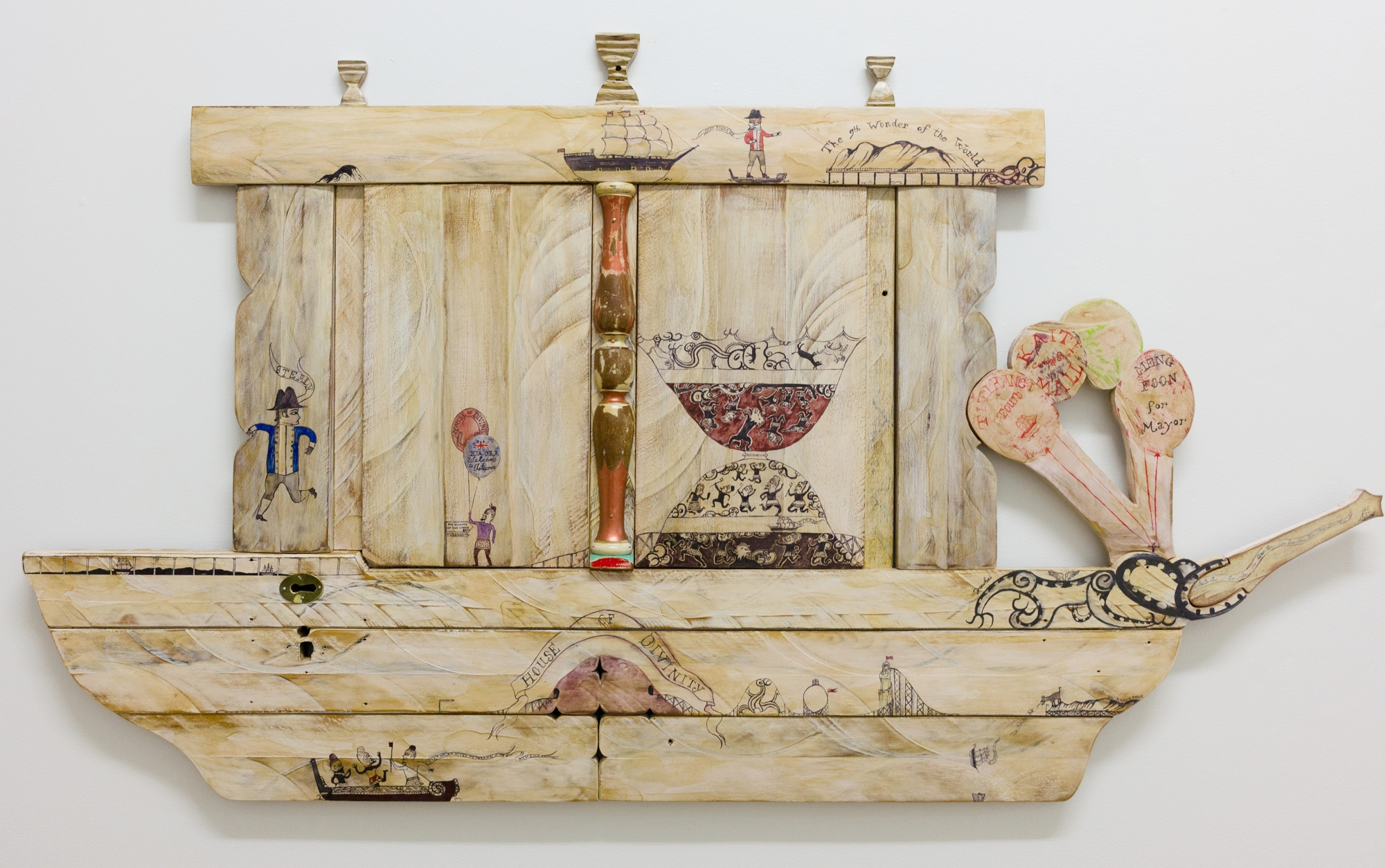 House of Divinity  2016 Paint and whakairo using reclaimed wood  1355 (H) x 775 (W) x 35mm (D)    This work explores our bi cultural journey within the metaphoric context of     a fun park looking at the de-contextual process of land and culture.
