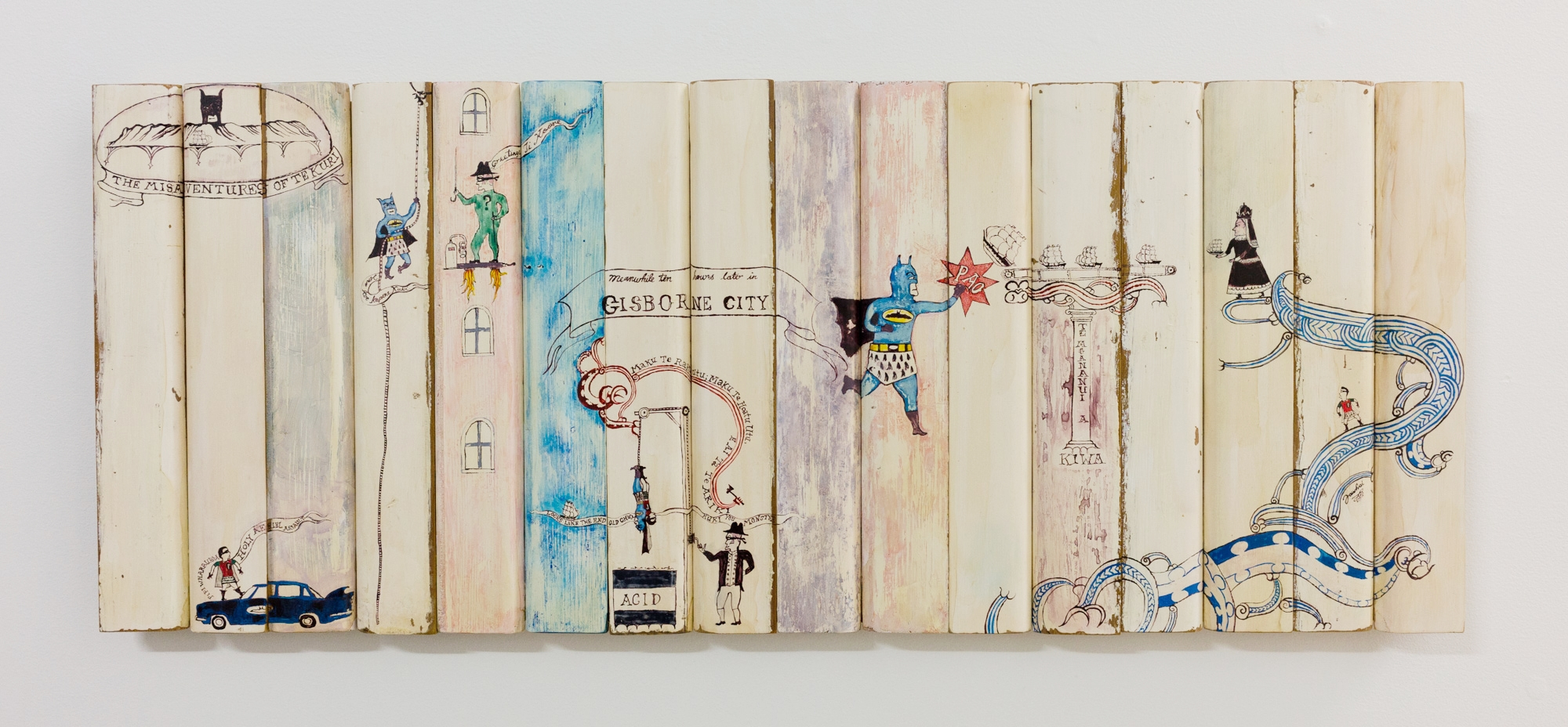 The Misadventures of Te Kuri 2016 Paint and whakairo using reclaimed wood 400 x 990 x 35mm    This work appropriates modern iconic pop culture as a metaphor that explores historical      and contemporary land and cultural issues concerning Tangata Whenua.