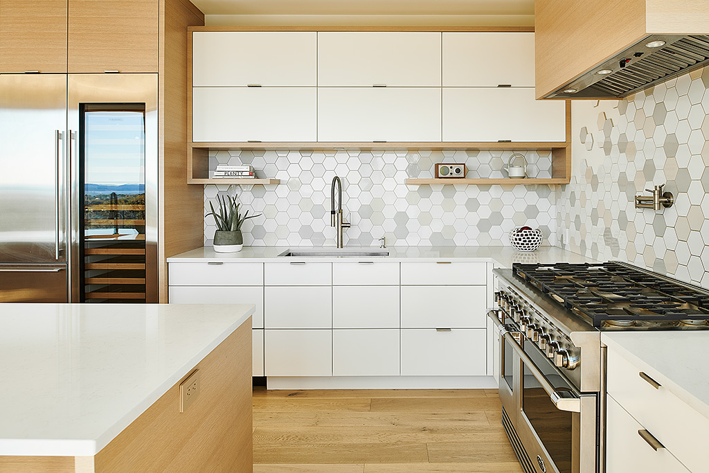 Modern Gourmet Kitchen of Rebuilt Modern House design and rebuild on steep lot on Gonzales Hill in Victoria BC by MDRN Built