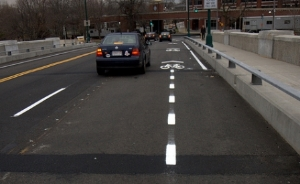 "BU Bridge bike lanes are narrow and even disappear at the end, where ""there is no room"" for safety."