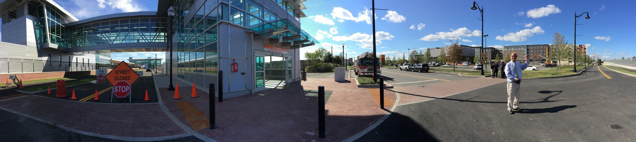 A panorama of the area awaiting development around the unfinished Assembly station entrance with Wig Zamore of the  MBTA Rider Oversight Committee  and chair of the  Union Square Civic Advisory Committee .