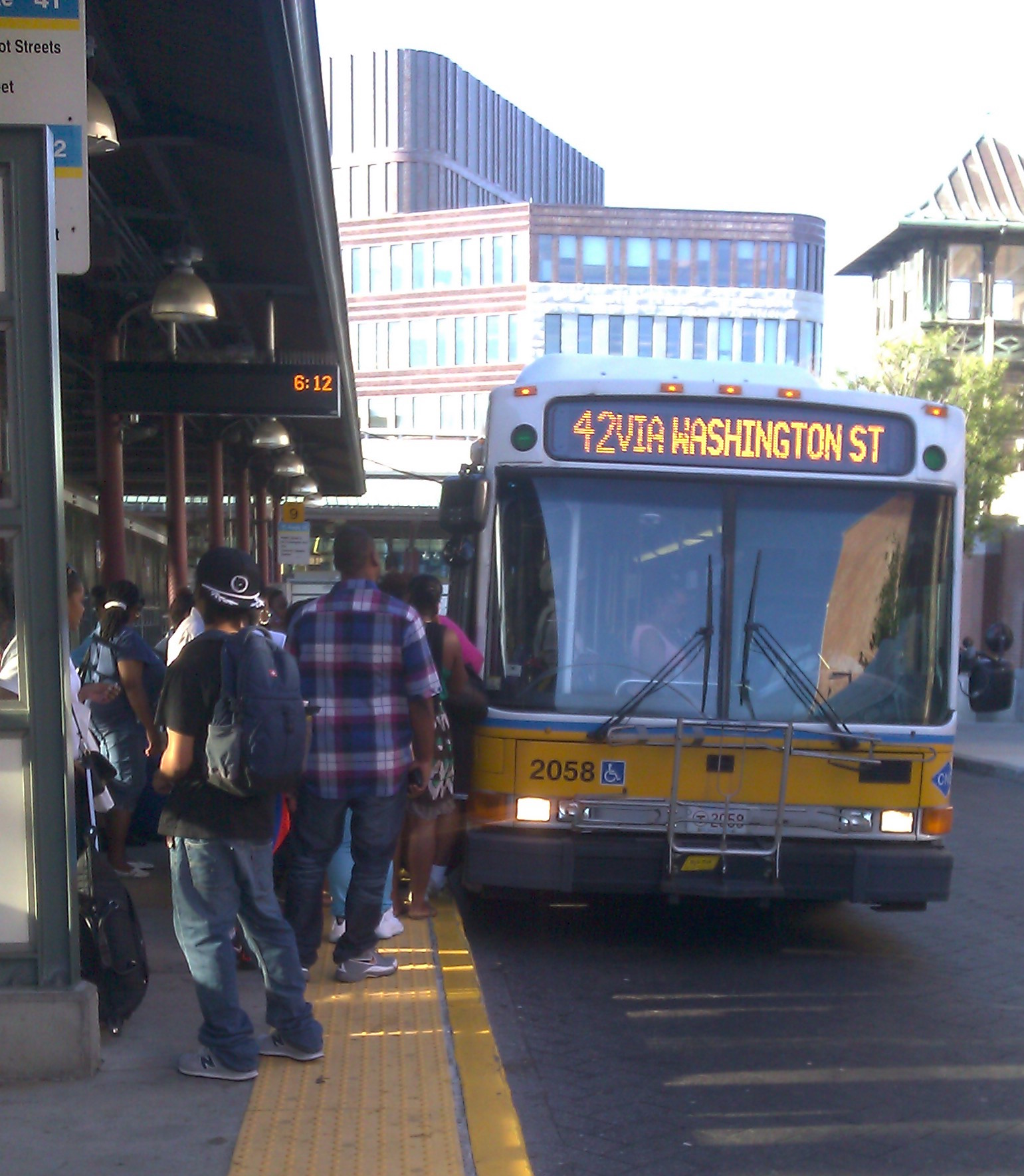 Passengers line up to board Route 42 at Dudley Station, increasing operating costs.