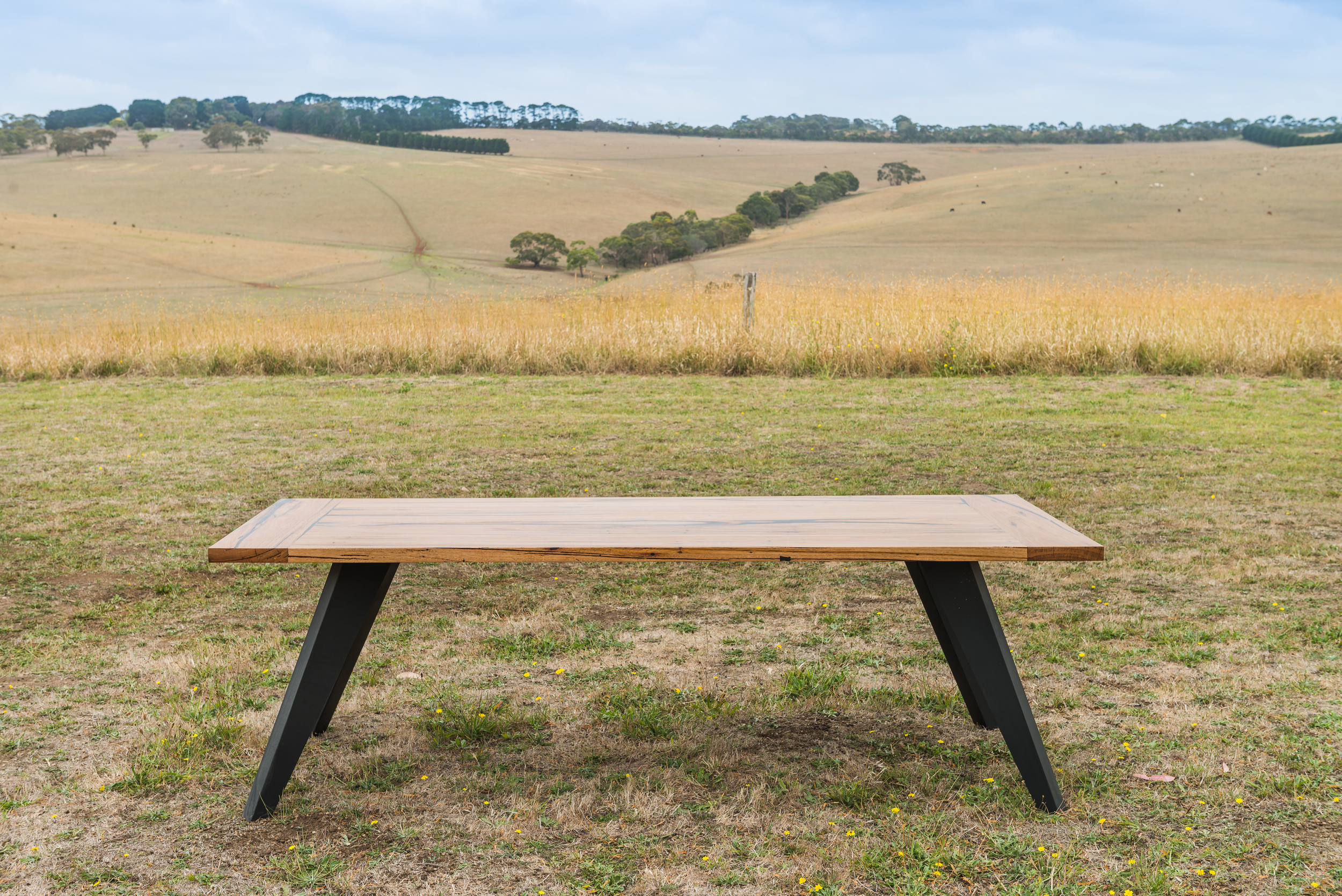 black leg timber dining table