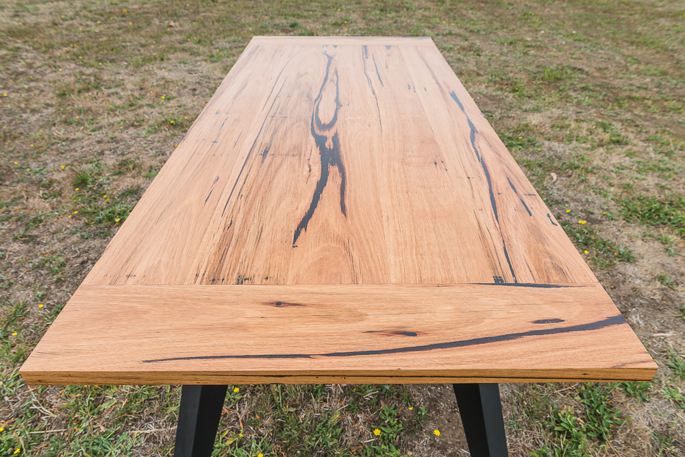 Zeally Bay recycled timber dining table with black angled legs