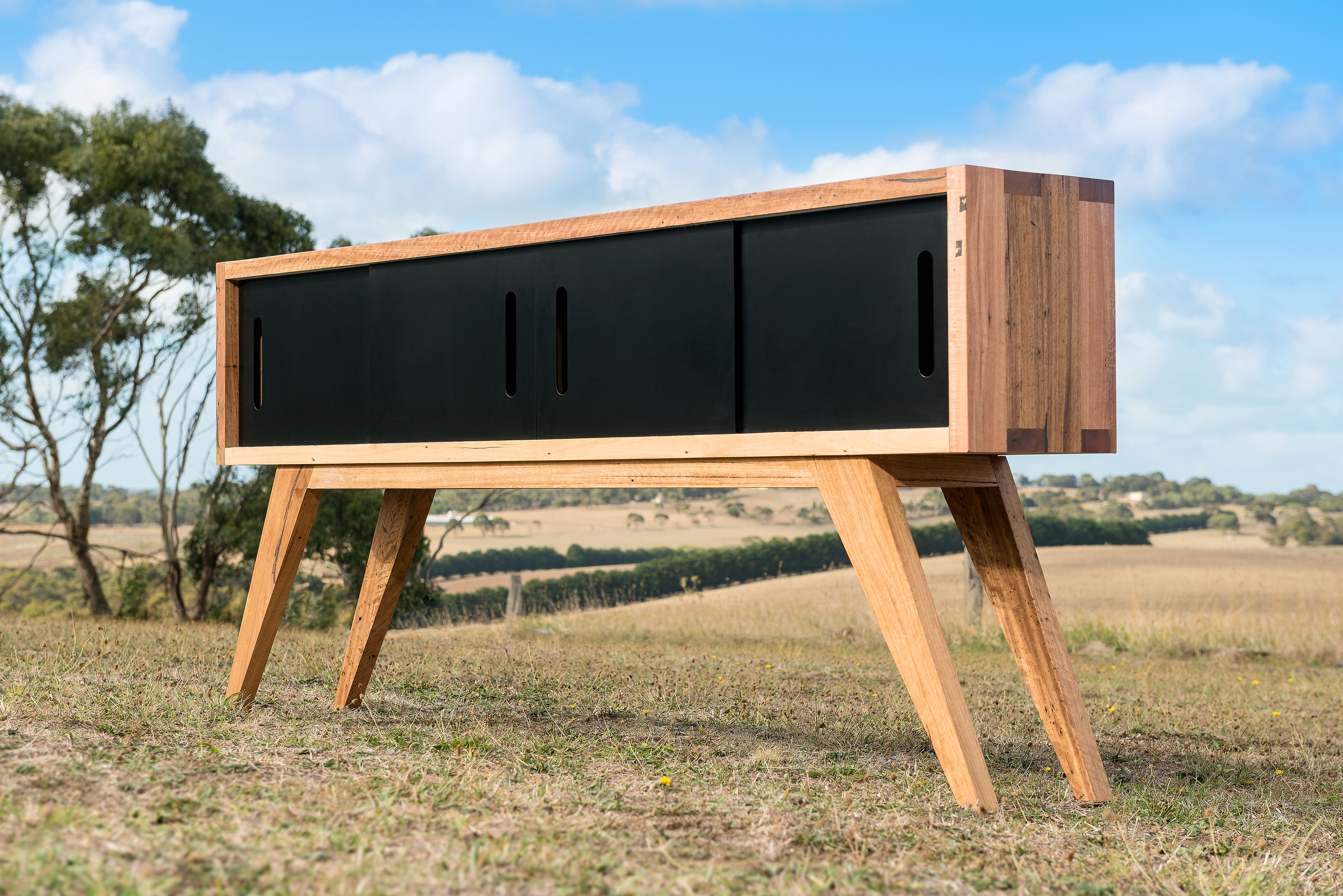 Timber sideboard with matte black metal doors