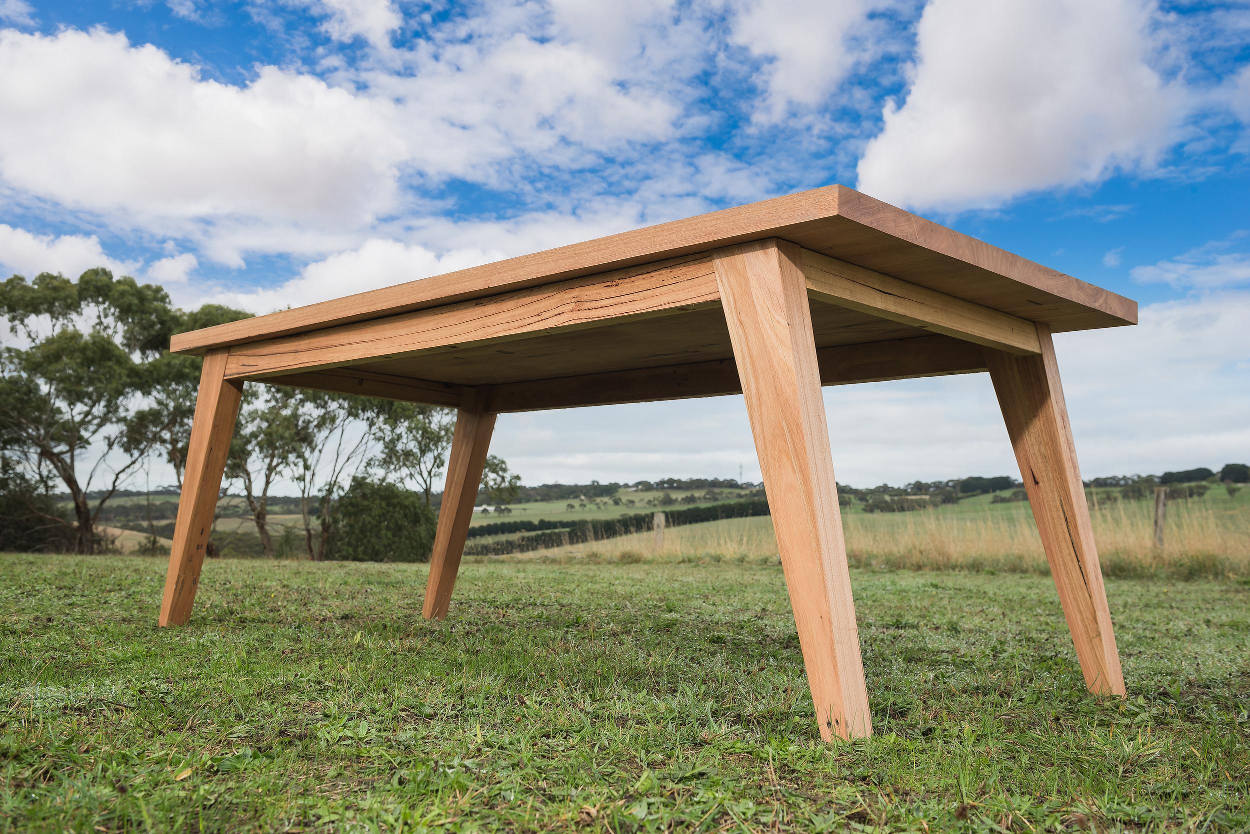 Angled leg solid timber table