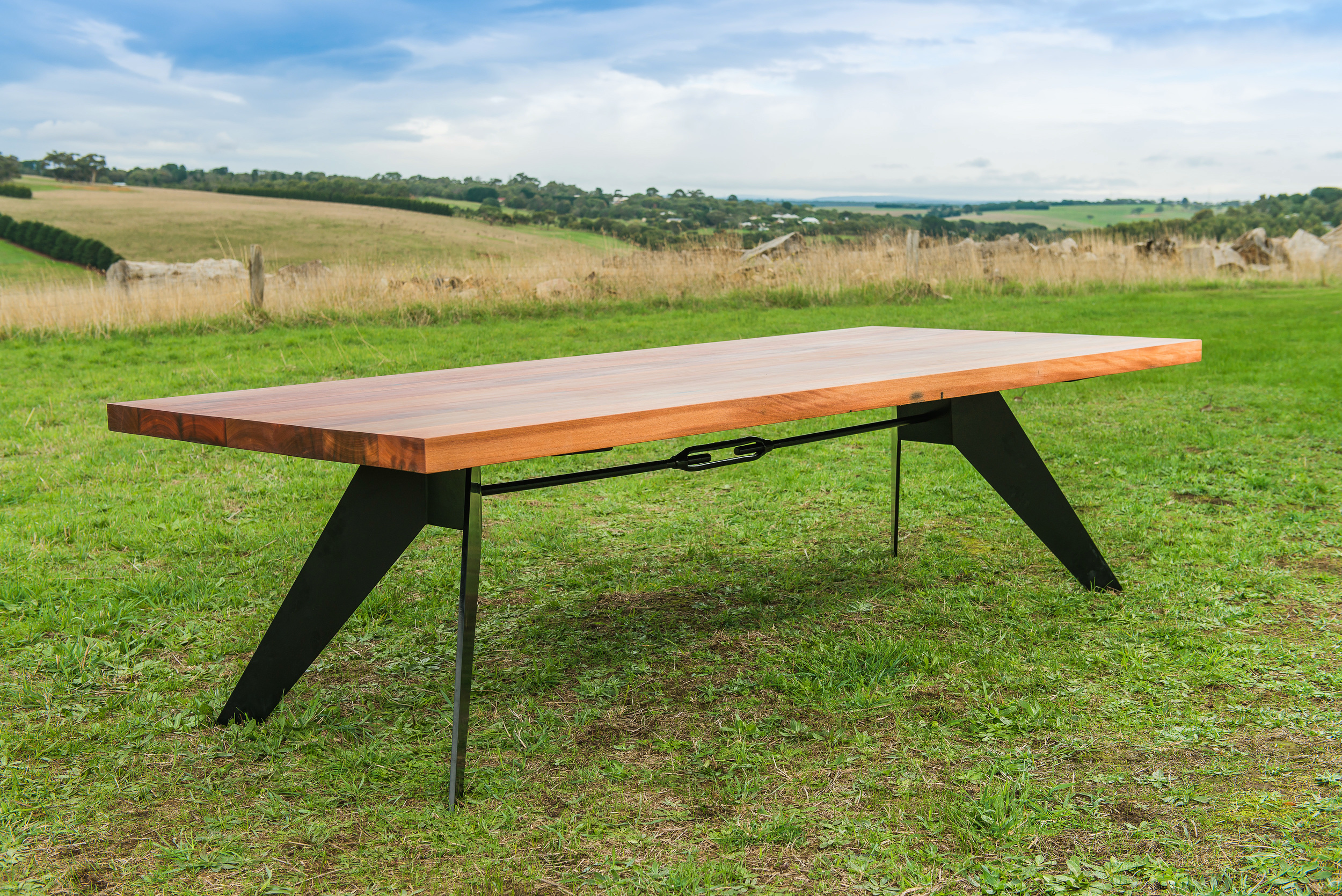 black metal and timber dining table