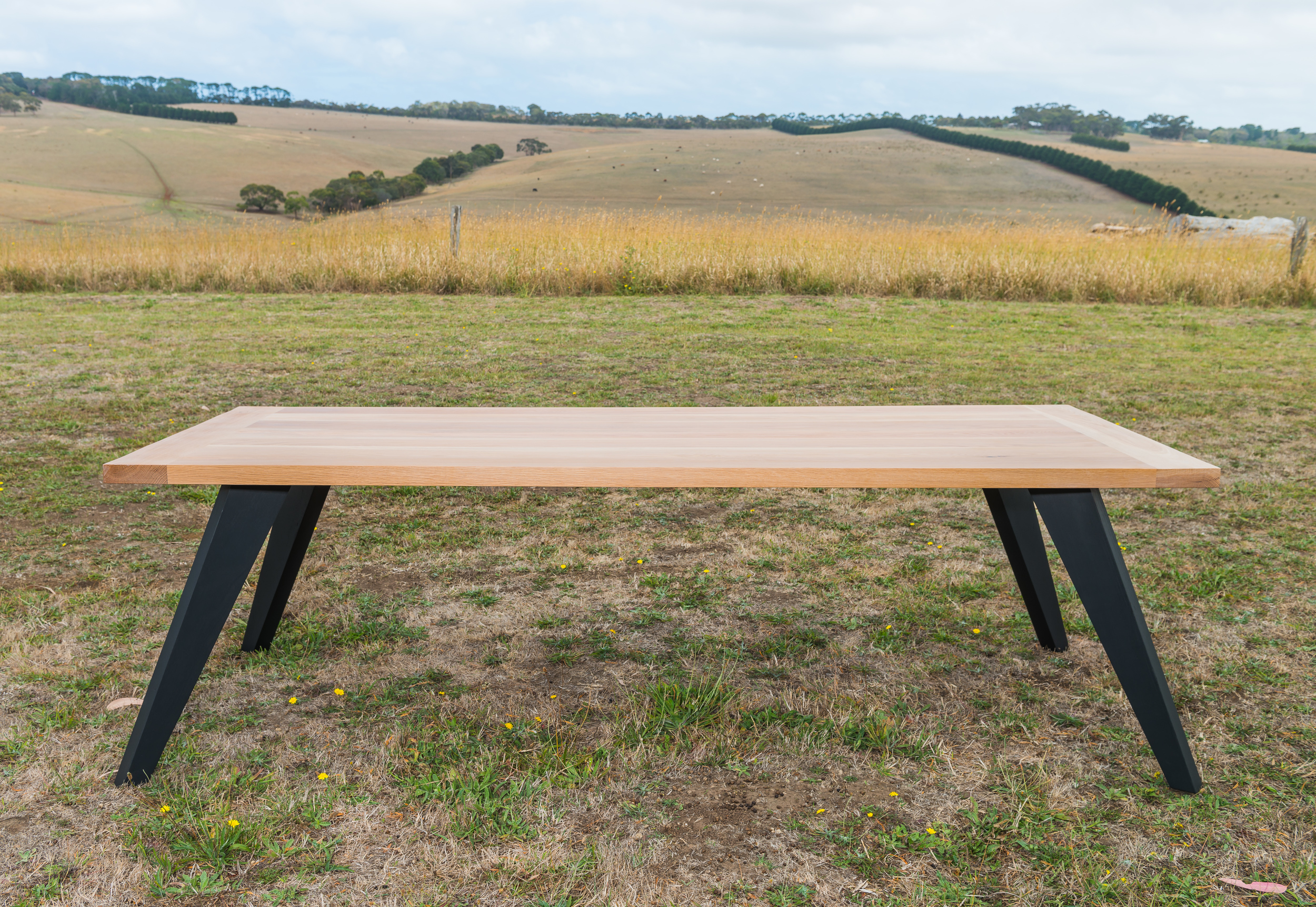 black and timber dining table melbourne