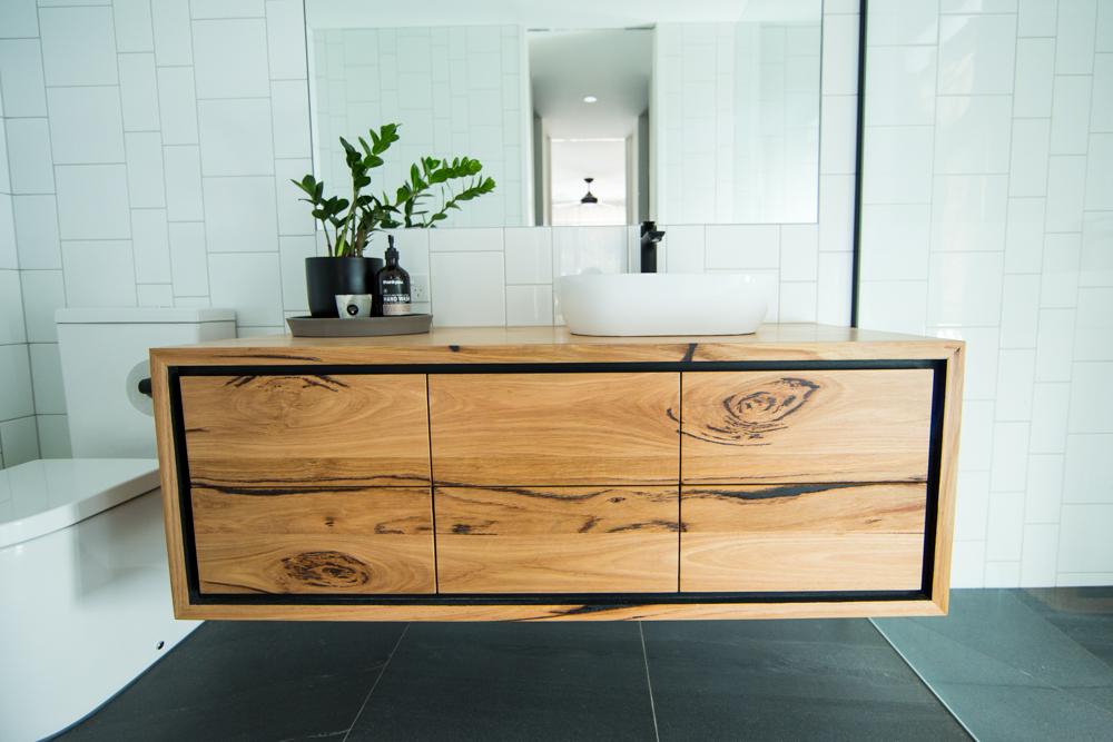 Bathroom vanity with black finger pulls