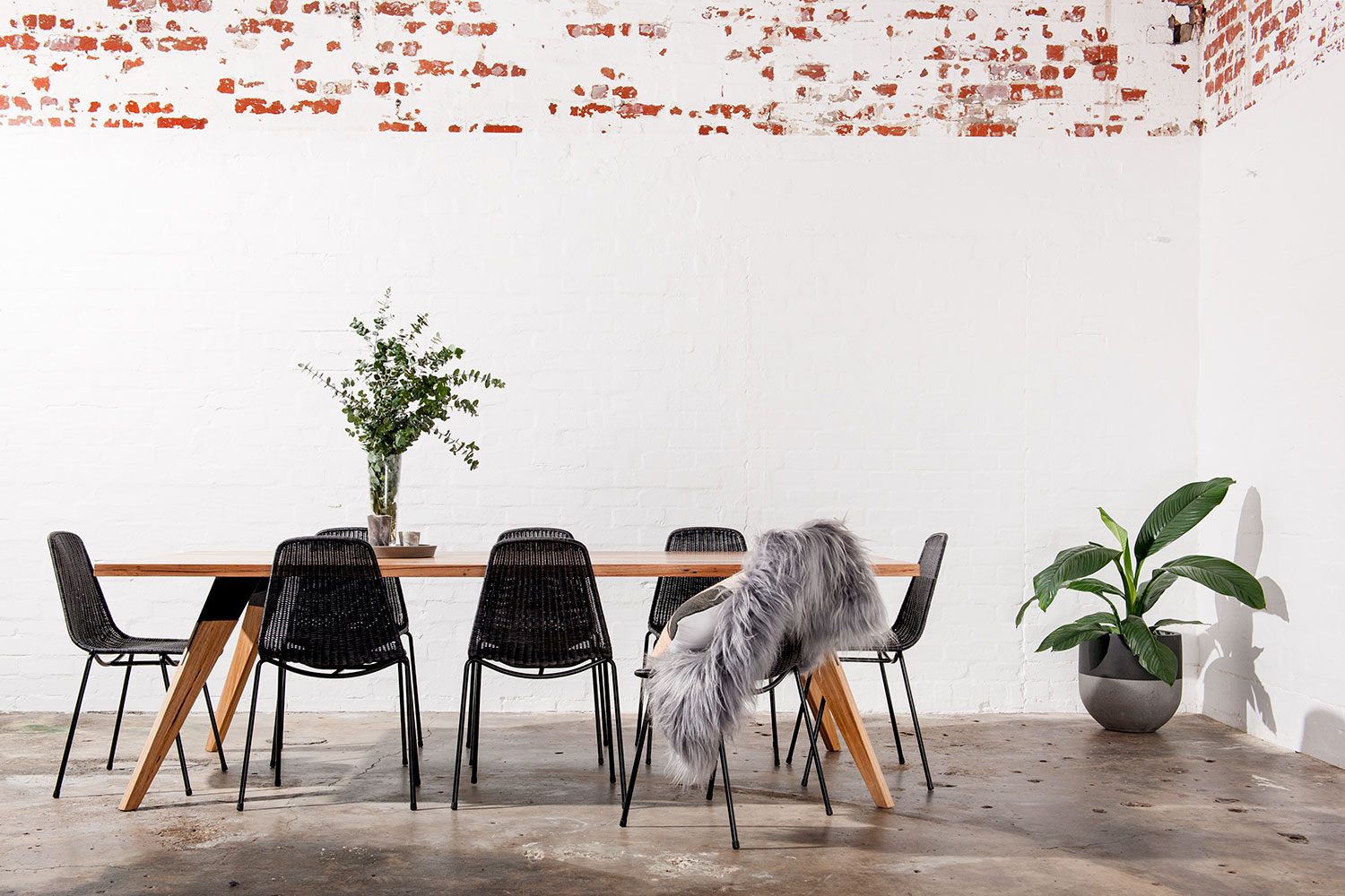 Black and timber dining table