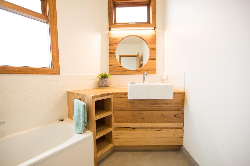 Asymmetrical timber vanity