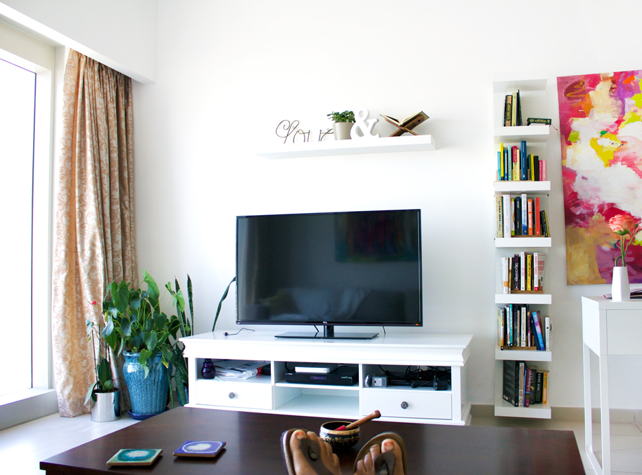 We simplified a lot in our living space. Cut out the big entertainment center for something more minimal and reflective of my personal style. (Trying to break in a new pair of Birks as well at home unsuccessfully)