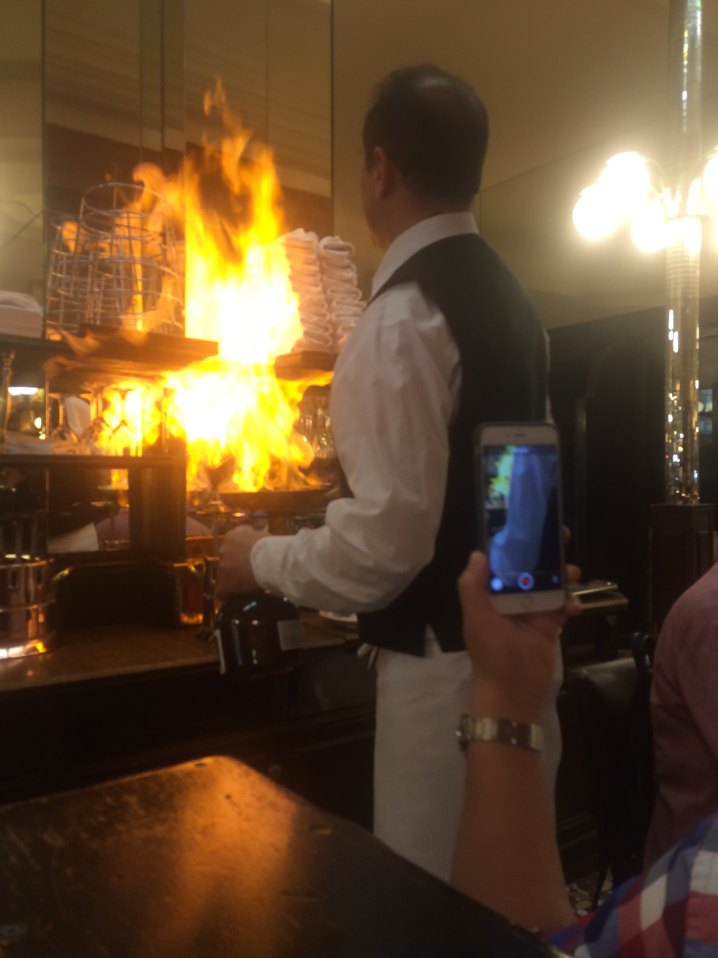 Enjoying the food while the waiter is trying to burn the restaurant.