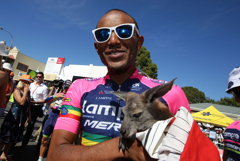 Stage2d-Lampre-Merida rider Tsgabu Grmay meets the local wildlife