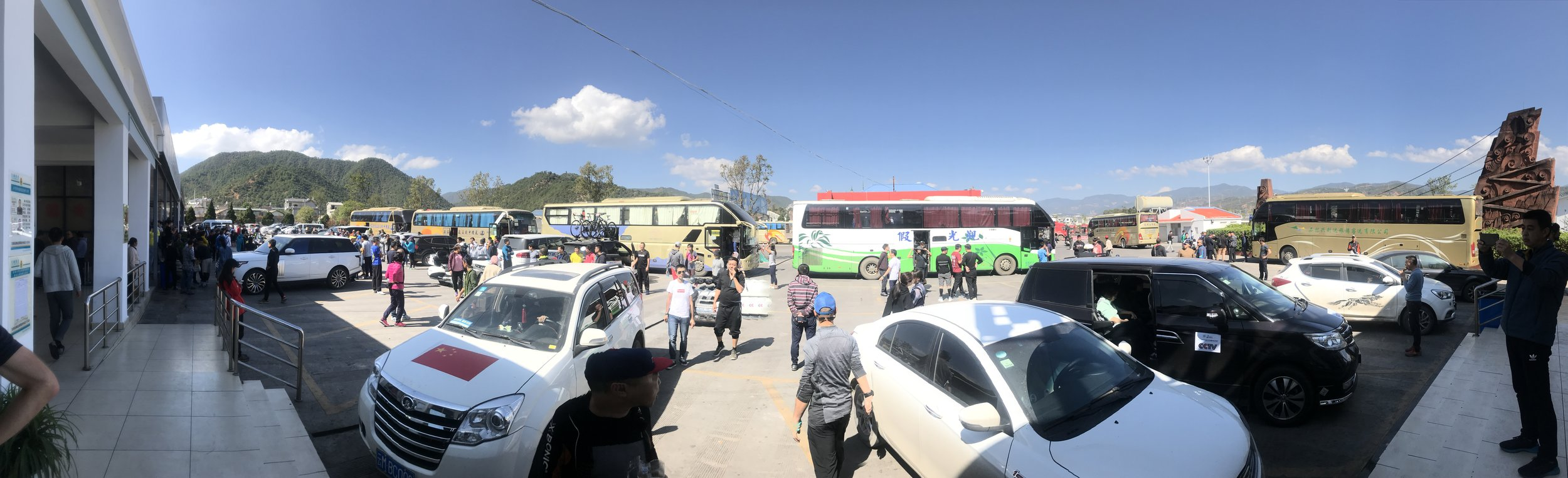 The entourage of riders at the service station.
