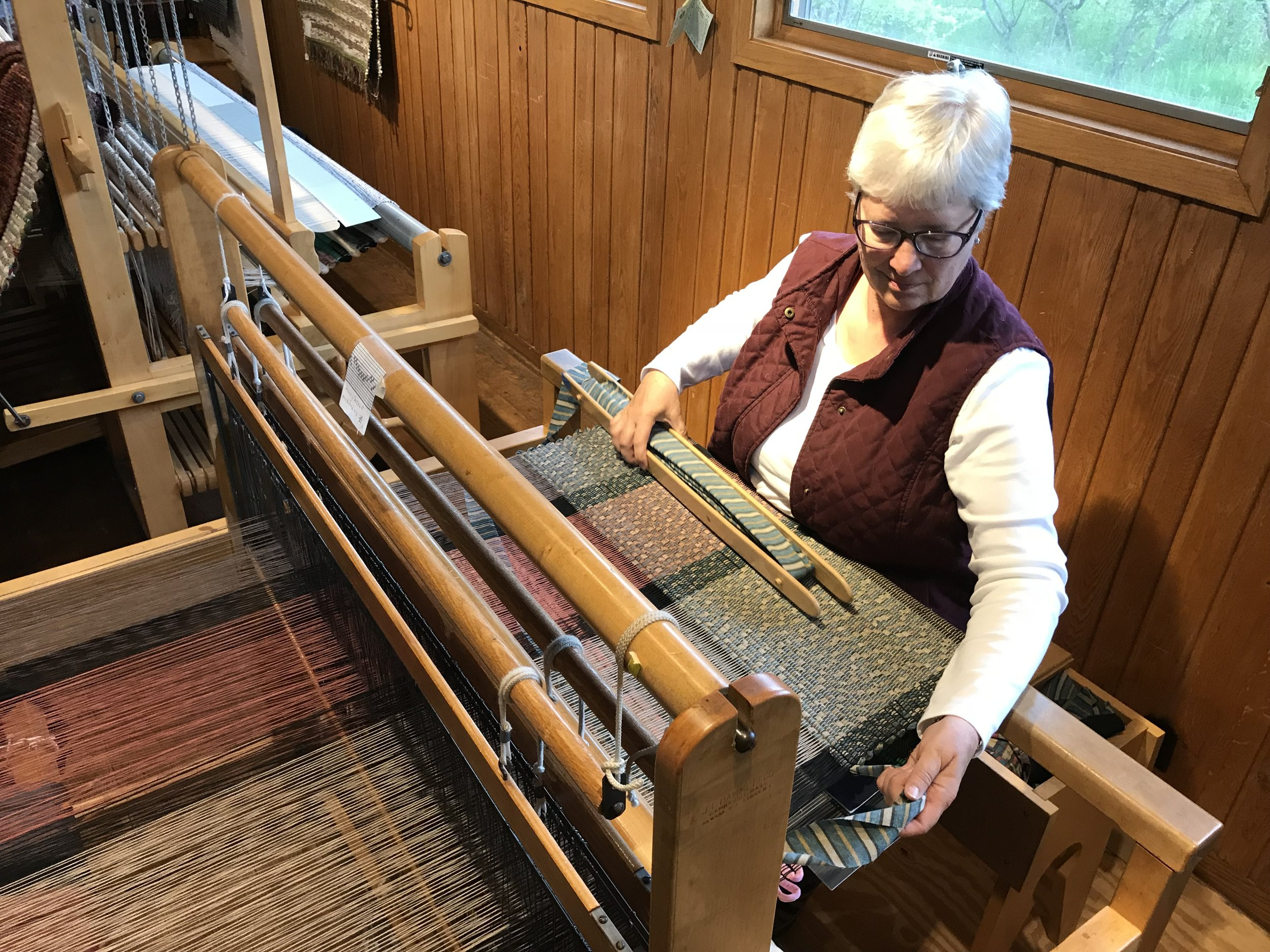 Karen Madson can often be heard beating away her weft on the rugs in the early mornings of summer. We love our mornings with Karen.
