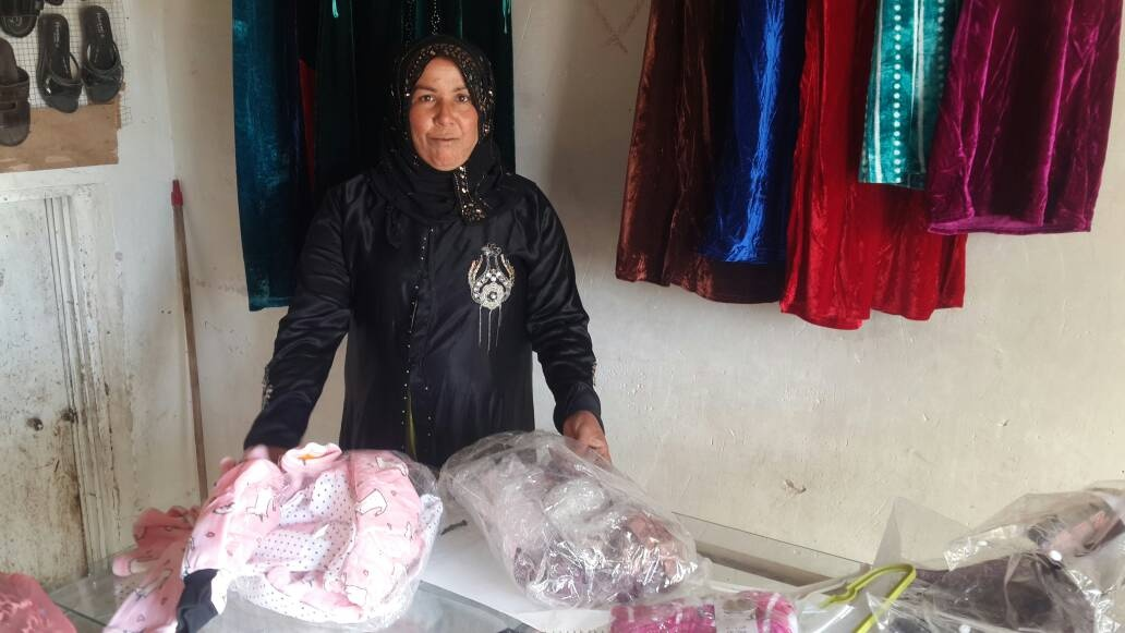 Sabeha unpacks her first stock for her store, October 2017. Photo by Bilal Anbar.