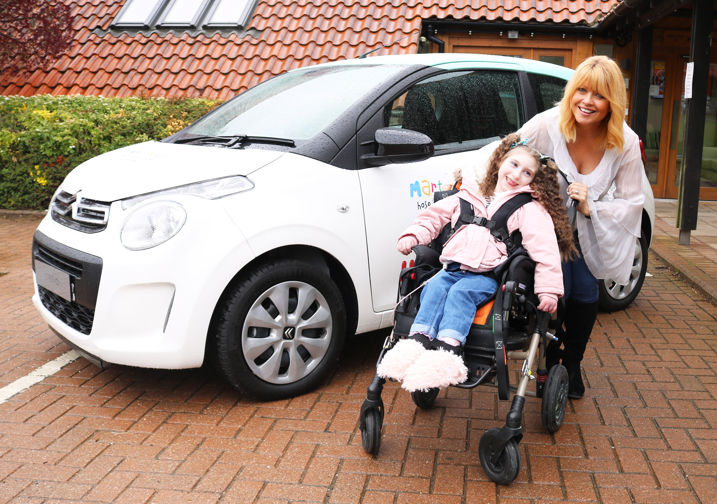 Christine Talbot launches the Martin House Grand Car Raffle with the help of Lacie-Lea Rennie.